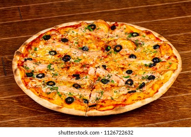 Pizza with salmon and black olives