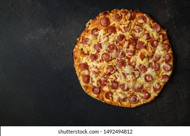 pizza with sausages (tomato sauce, cheese, meat). food background. top view. copy space