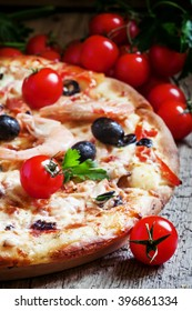 Pizza with seafood and black olives, selective focus