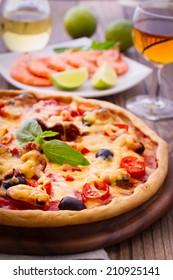 Pizza with seafood. Seafood Italian Pizza slice on wood dish (originality). Italian kitchen. Studio.