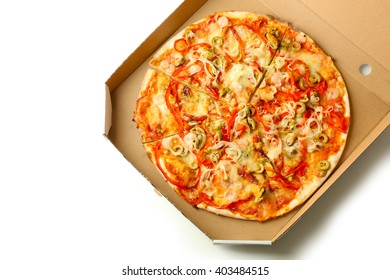 Pizza with seafood, red pepper and green olives in cardboard box, isolated on white