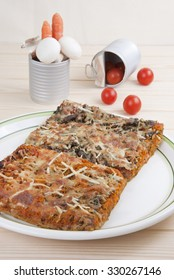 Pizza with spinach, carrots and mushrooms. Vegetarian Food, italian food, vegetable pizza, square portions