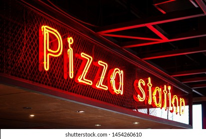 Pizza station red neon light tube decoration sign in restaurant bar