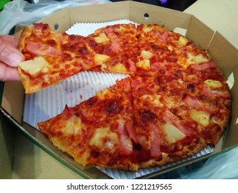 Pizza with thin slices in Thailand.