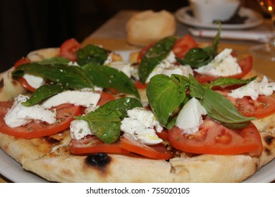 Pizza with tomato, mozzarella and basil