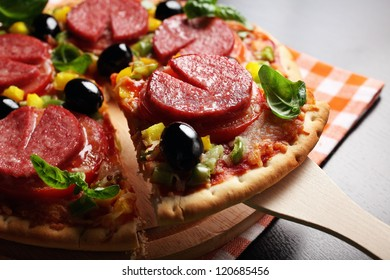 Pizza with tomato, salami, olives and basil