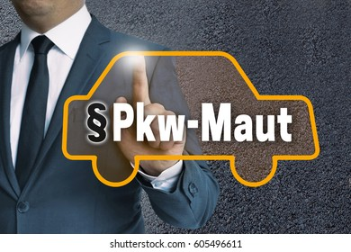 PKW-Maut (in german Car toll) auto touchscreen is operated by businessman concept.