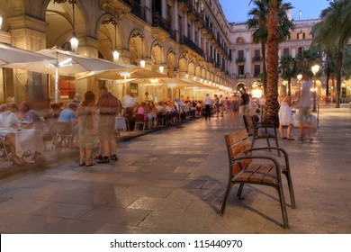 Placa Reial (Royal Plaza) in the old quater of Barcelona, Spain at night.