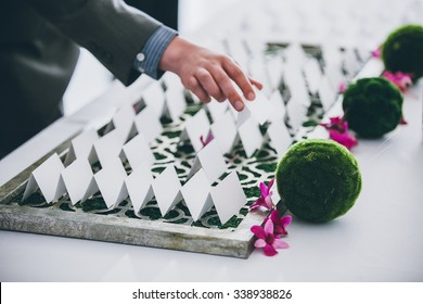 Place Card being picked up