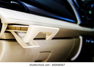 Place of coffee or tea mugs or bottle on the vehicle console in modern luxury car interior