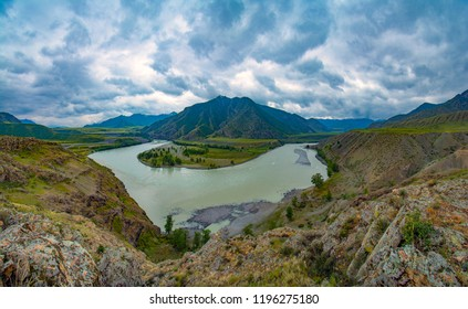 The place is the confluence of two famous altai rivers Chuya and Katun. Panorama of the Katun river valley in a beautiful sunny day. Rest on the Katun River. Altai landscape