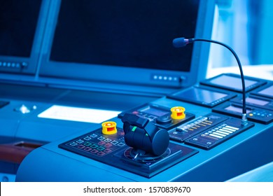 Place to control the ship. Captain's bridge. Helm of a modern ship. Place of the captain of the ship. Concept - control of a marine vessel. Microphone on the captain?s bridge. Yacht management