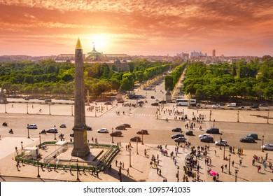 Place de la Concorde with Louxor obelisk and people at sunrise. Paris, France. Panoramic view with Les Champs-Elysées background.