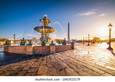 The Place de la Concorde, one of the major public squares in Paris, France and the north fountain, devoted to the rivers at golden hour.