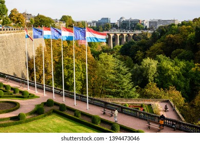 Place de la Constitution, Luxembourg City, Luxembourg - October 13, 2016: The view over the flags by Place de la Constitution and into the Vallee de la Petrusse