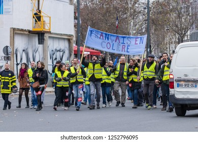 """Place de la Republique, Paris, France - December 08, 2018 : Demonstrators with yellow vests (""""gilets jaunes"""" in french) protest against the increase of fuel cost, excessive living costs"""