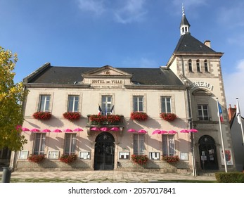Place de L'Hotel de Ville Boussac France. October 13 2021. View of Boussac Town Hall set against the sunlight and shadow located in the French department of Creuse in rural central France.