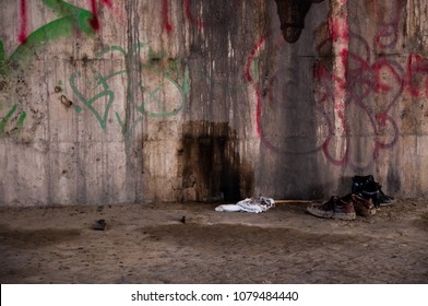 Place of decay and abandonment with old shoes