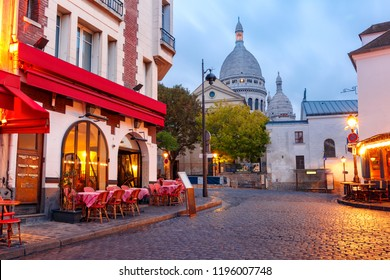 The Place du Tertre with tables of cafe and the Sacre-Coeur in the morning, quarter Montmartre in Paris, France
