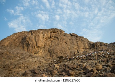 "Place of first revelation to Prophet Muhammad. Muslim pilgrims climb the Mount of light ""Jabal An-Nour"" where located the Hira cave. Mecca - Saudi Arabia: 26 August 2018"