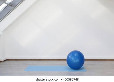 Place for fitness exercises, fitball and mat lie on the floor
