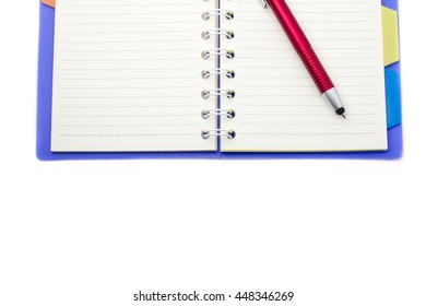 Place the pen on notebook on white background.