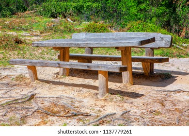 place for picnic with wooden chair and table in the park