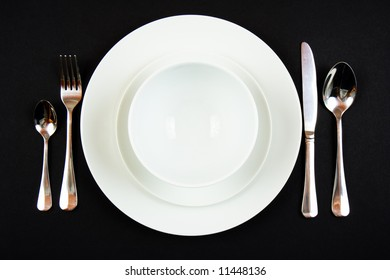 A place setting at a dining table for dinner