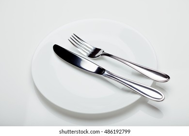 Place setting with knife, fork, play.