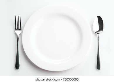 Place setting with plate, spoon and fork