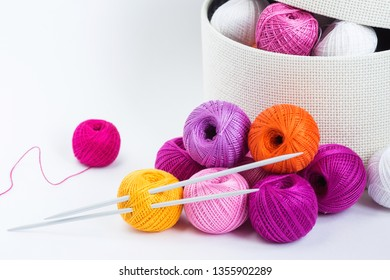 Place of work of the tailor with multi-colored threads. Knitting as a hobby. White background. Minimal style. Russia, Moscow, April 2019