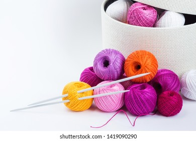 Place of work of the tailor with multi-colored threads. Knitting as a hobby. White background. Minimal style.