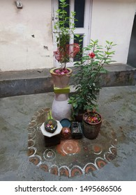 A place of worship in the centre of the courtyard of a hindu house  marked  with cow dung red soil and lime.Small shivling,hibiscus and holy basil plants which are highly revered in hinduism are there