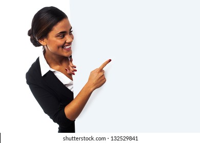 Place your business ad here. Woman pointing at blank whiteboard.