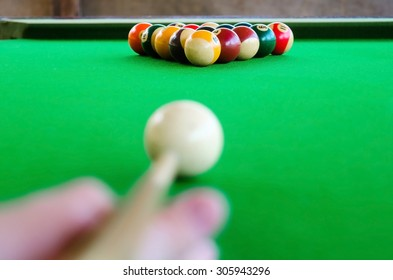 Placement of billiard balls on the table before the game. Focus on the white ball