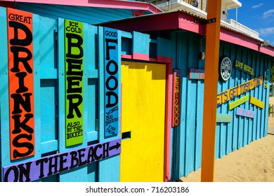 PLACENCIA, BELIZE - FEBRUARY 15, 2014: Colorful food stands in Placencia, Belize