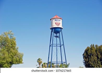 "PLACENTIA/CALIFORNIA - APRIL 22, 2018: Placentia landmark water tower. The logo and red, white and blue colors designates Placentia as ""All America City"". Placentia, California USA"