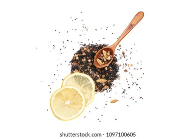 Placer Indian black tea with a mix of spices for Masala Chai, wooden spoon and two thin slices of fresh lemon. Isolated on white background, top view, flat lay, copy space