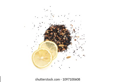 Placer Indian black tea with a mix of spices for Masala Chai and two thin slices of fresh lemon. Isolated on white background, top view, flat lay, copy space