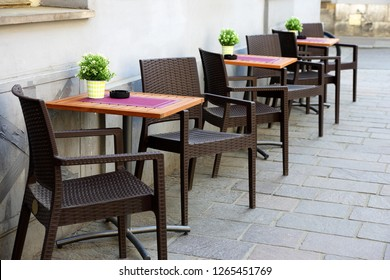 places for two at the table in a street cafe