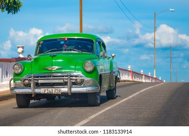 Placetas, Cuba- August 4, 2018: Vintage Chevrolet car driving in a Cuban road. Obsolete cars still working has become a tourist attraction in the Caribbean Island