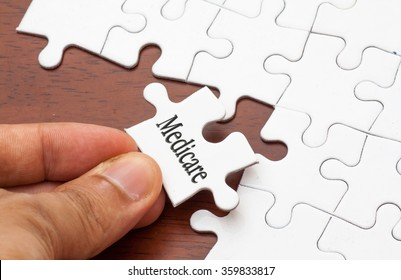 Placing missing a piece of puzzle with medicare word