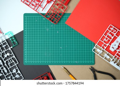 Plactic model kit unassemble on brown background with cutting board