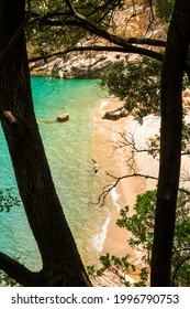 Plage de Ficaghiola, Corsica, France - 22nd June 2021: Holidaymakers enjoying the sunshine and turquoise Mediterranean sea at the secluded Plage de Ficaghiola near Piana on the west coast of Corsica