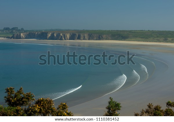 Plage de Goulen, long waves, fabulous sandy beach on the Atlantic coast for surfing, windsurfing in Crozon peninsula, Finistère, Brittany, France.