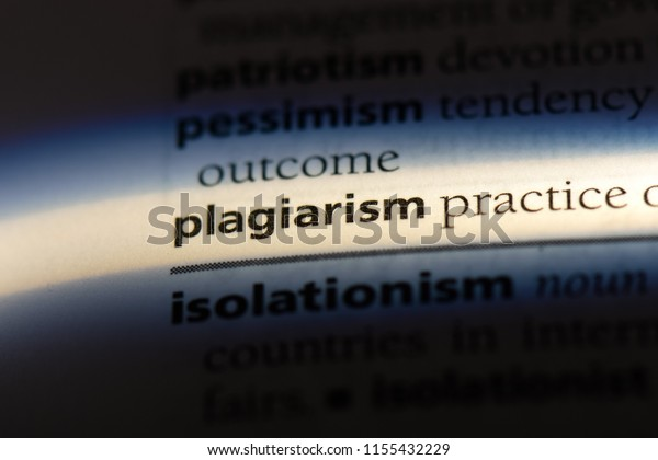 plagiarism word in a dictionary. plagiarism concept.