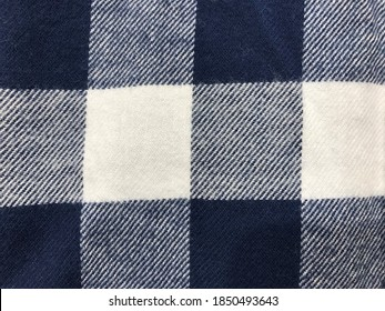 Plaid check patten in dark navy, blue and white. Fabric texture.