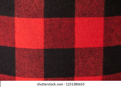 Plaid flannel material laid out and shot up close