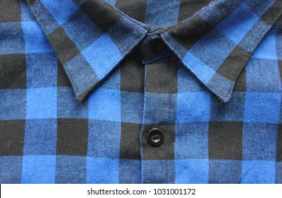 6afe0ef1bd395f Plaid Shirt of Blue and Black Checkered Tartan Pattern. Close Up View of  Collar and