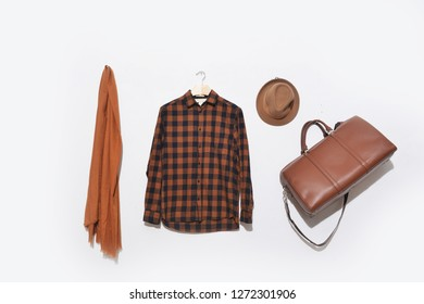 Plaid Shirt on hanging with scarf, hat, leather handbag on white